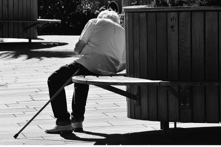 Neglected senior on a bench
